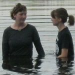 teen girl being baptized